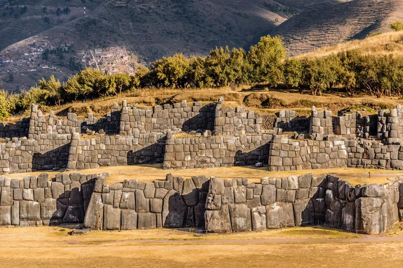 Walls of Sacsayhuaman archeological site at sunset, Cusco, Peru royalty free stock image