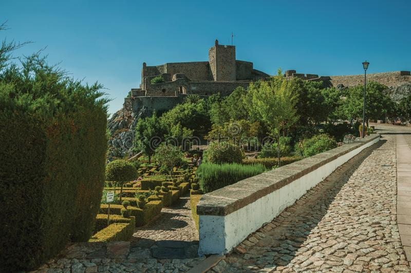 Walls and stone tower of the city Castle over the hill stock photos