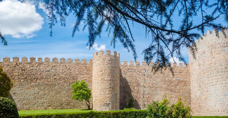 Walls surrounding Spanish city of Avila, turrets. Walls surrounding Spanish city of Avila landscape turrets royalty free stock image