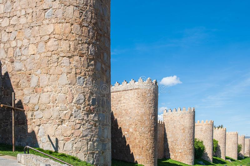 Walls surrounding Spanish city of Avila, turrets. Walls surrounding Spanish city of Avila landscape turrets royalty free stock photography