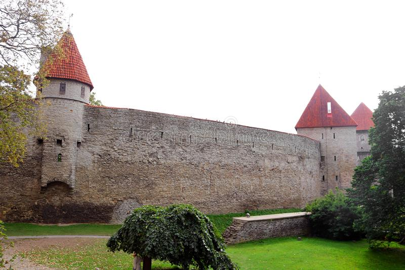 Walls of Tallinn fortress, Estonia. The walls and the many gates are still largely extant today. This is one of the reasons that Tallinn`s old town became a stock photography