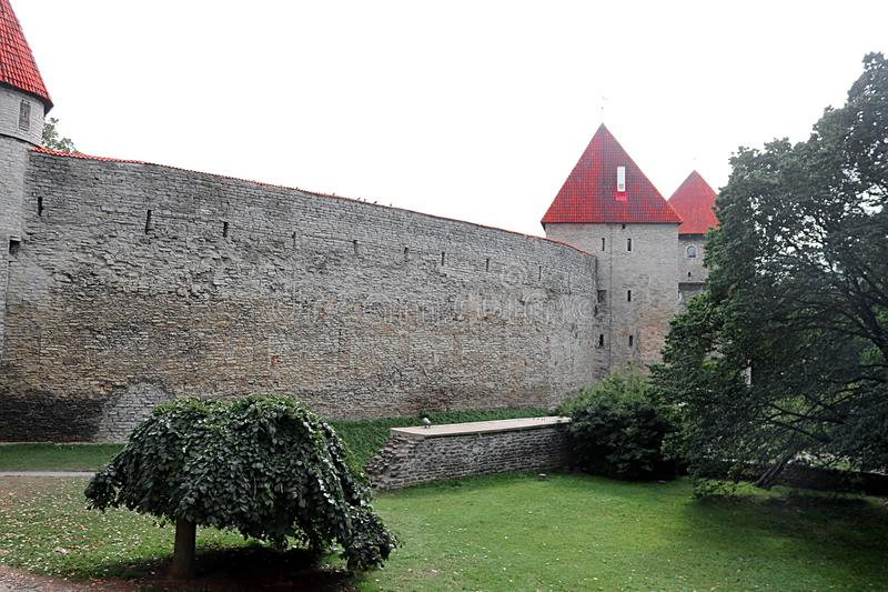 Walls of Tallinn fortress, Estonia. The walls and the many gates are still largely extant today. This is one of the reasons that Tallinn`s old town became a royalty free stock photos