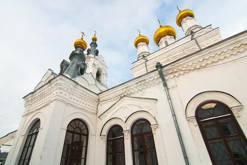 Walls, towers and cupolas of old Orthodox cathedral. Golden cupolas, walls and towersof old ancient cathedral on the sky background royalty free stock photography
