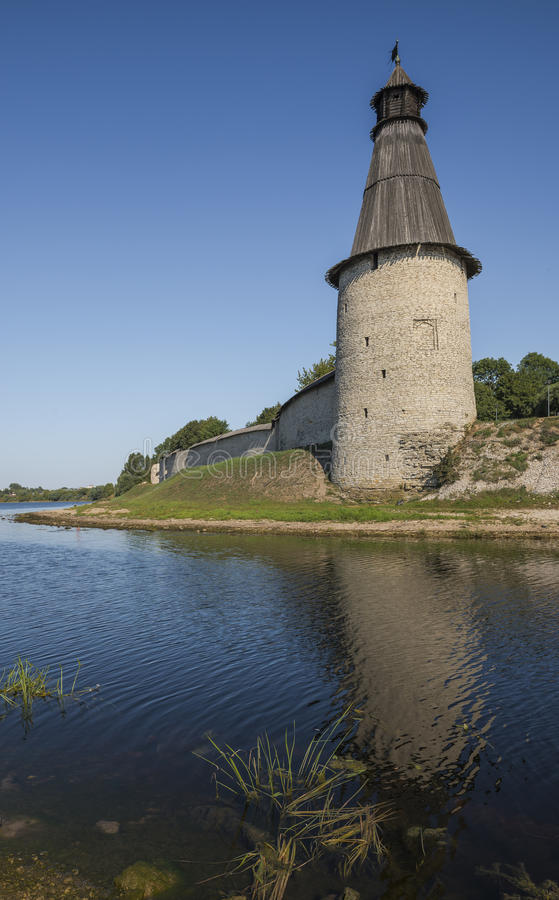 The walls and towers of Pskov Kremlin on the banks of the river royalty free stock images