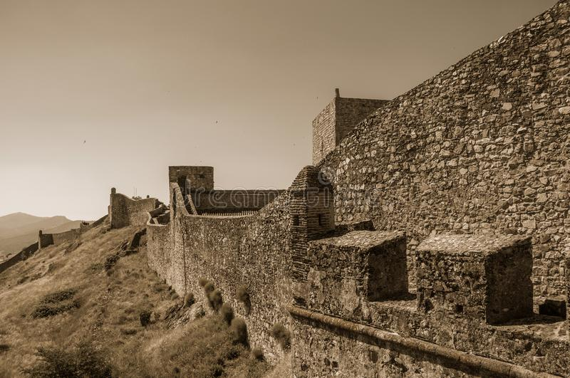 Walls and watchtowers over rocky hill at the Marvao Castle stock images