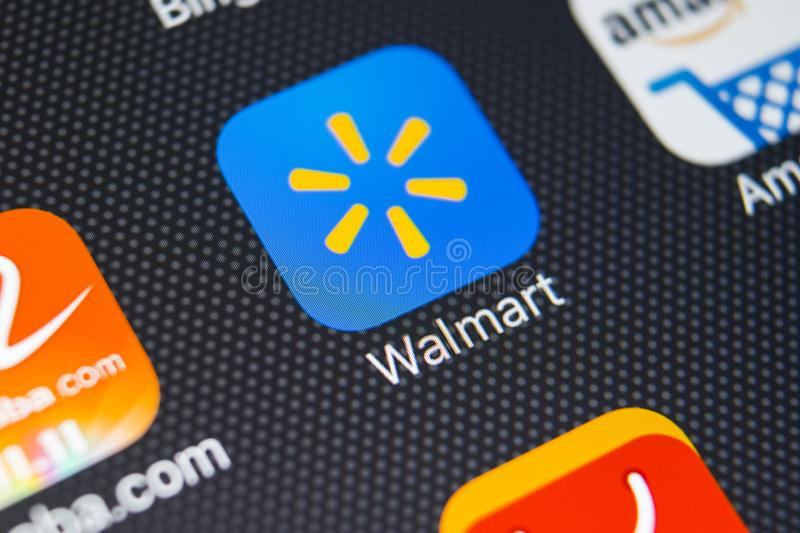 Walmart application icon on Apple iPhone X screen close-up. Walmart app icon. Walmart.com is multinational retailing corporation royalty free stock images