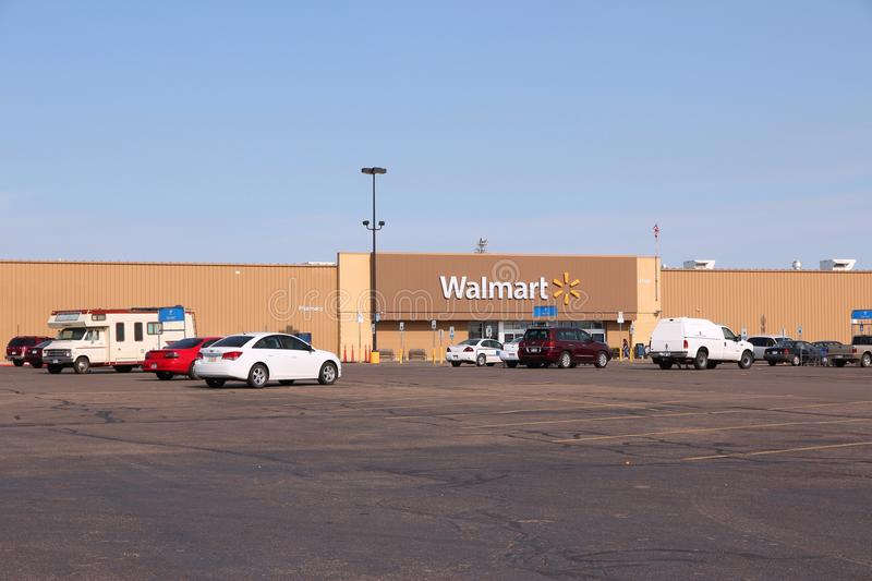 Walmart. GOODLAND, KANSAS - JUNE 25: People visit Walmart on June 25, 2013 in Goodland, Kansas. Walmart is a retail corporation with 8,970 locations and revenue stock photography
