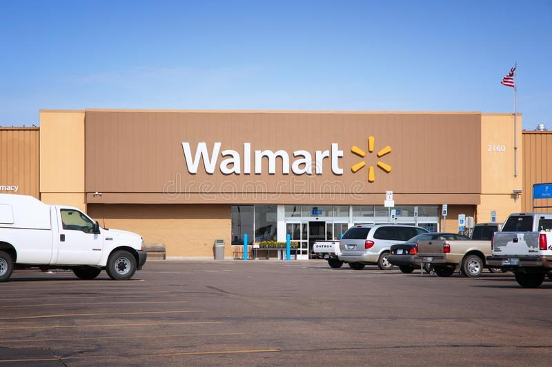 Walmart store. GOODLAND, USA - JUNE 25, 2013: People visit Walmart in Goodland, Kansas. Walmart is a retail corporation with 8,970 locations and revenue of US$ royalty free stock photos