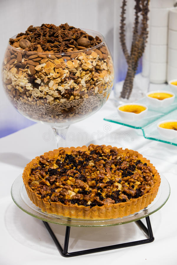 Walnut cake on a glass tray royalty free stock images