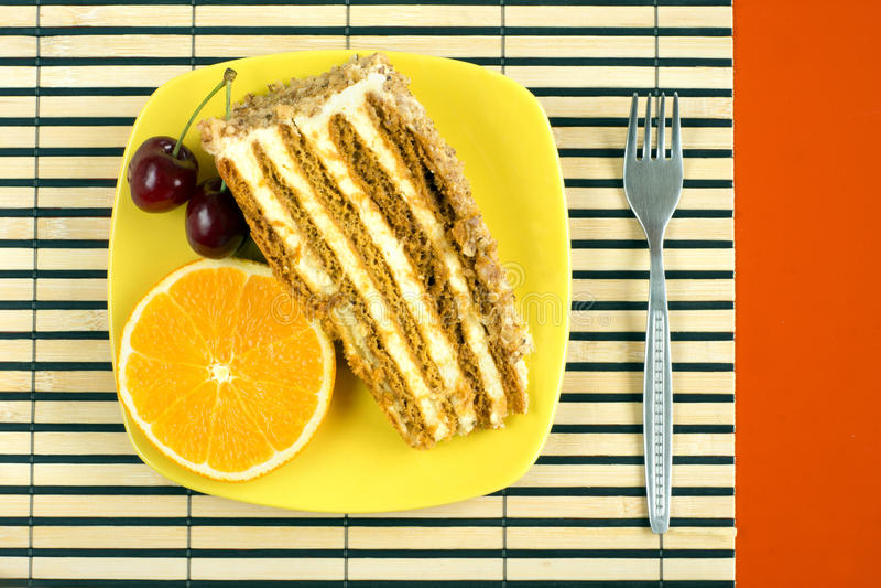 Walnut cake. Nut cake garnished with a cherry and orange slice stock photography