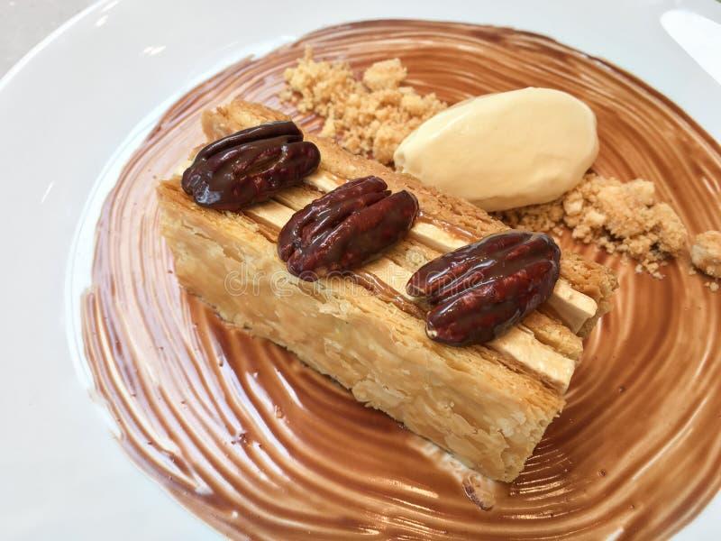 Walnut caramel pastry with vanilla ice cream stock photography