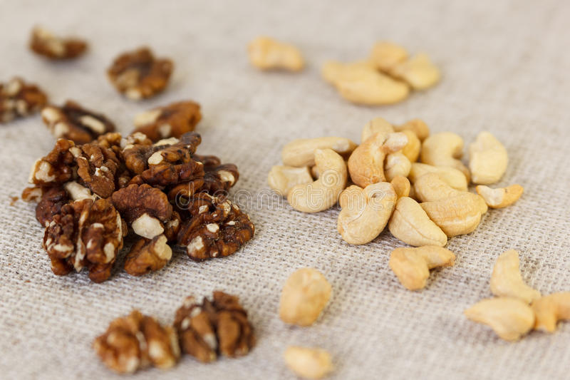 Walnut and cashew in half royalty free stock images