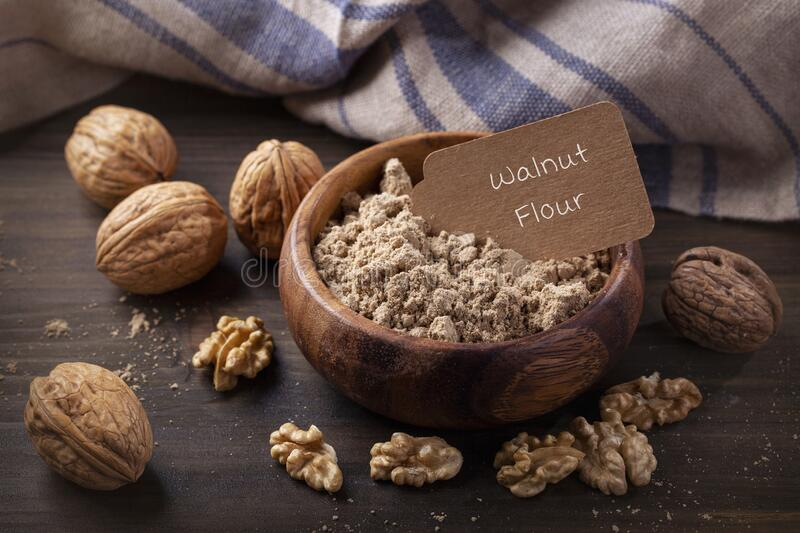 Walnut flour in the wooden bowl stock photos