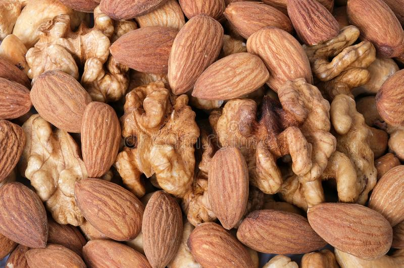 Walnut kernels, almonds and roasted cashew royalty free stock images