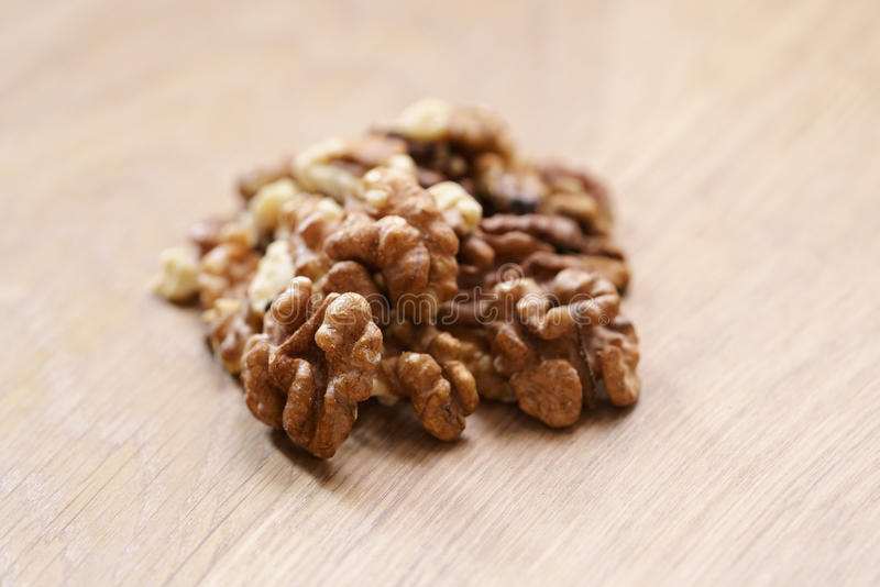Walnut kernels on aok wood table close up. Selective focus stock image