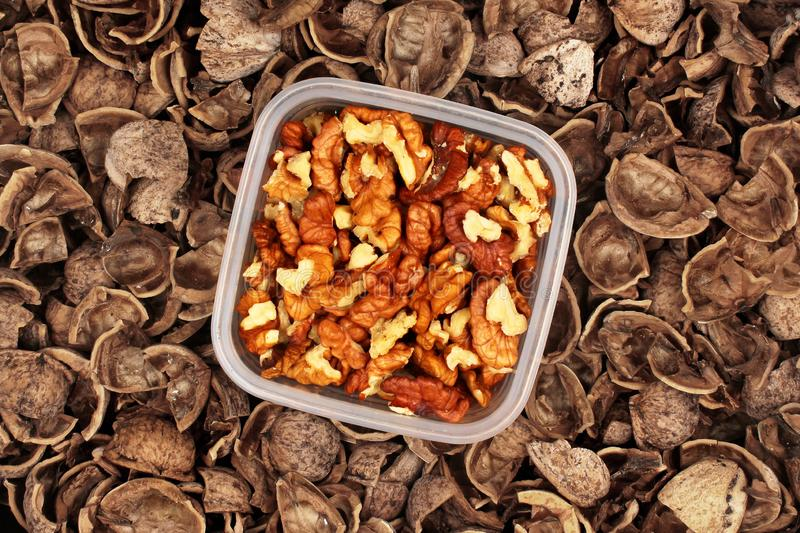 Walnut kernels and shells as background.  stock photography