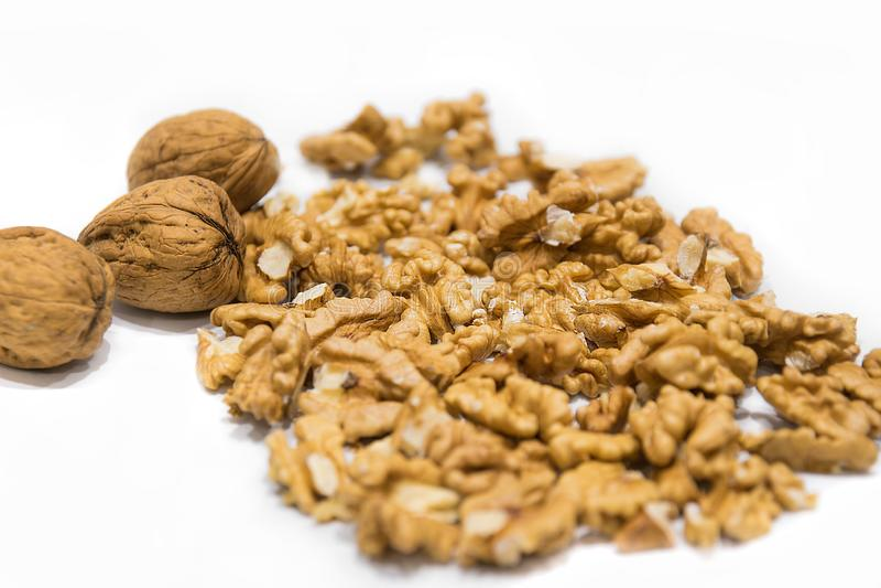 Walnut kernels and whole nutshell closeup macro, isolated on a white background royalty free stock photo