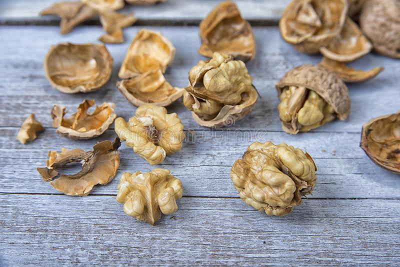 Walnut kernels and whole walnuts on the rustic grunge table.  stock images