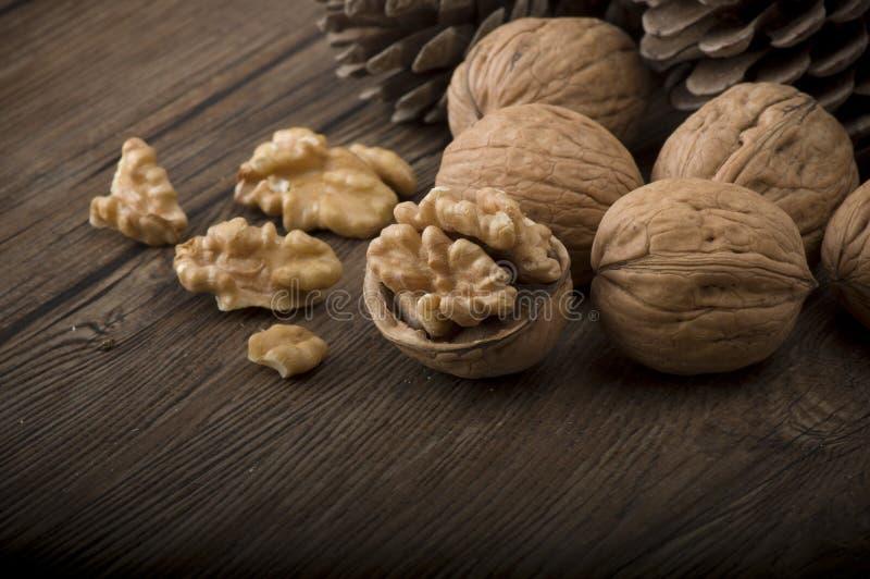 Walnut kernels and whole walnuts stock image