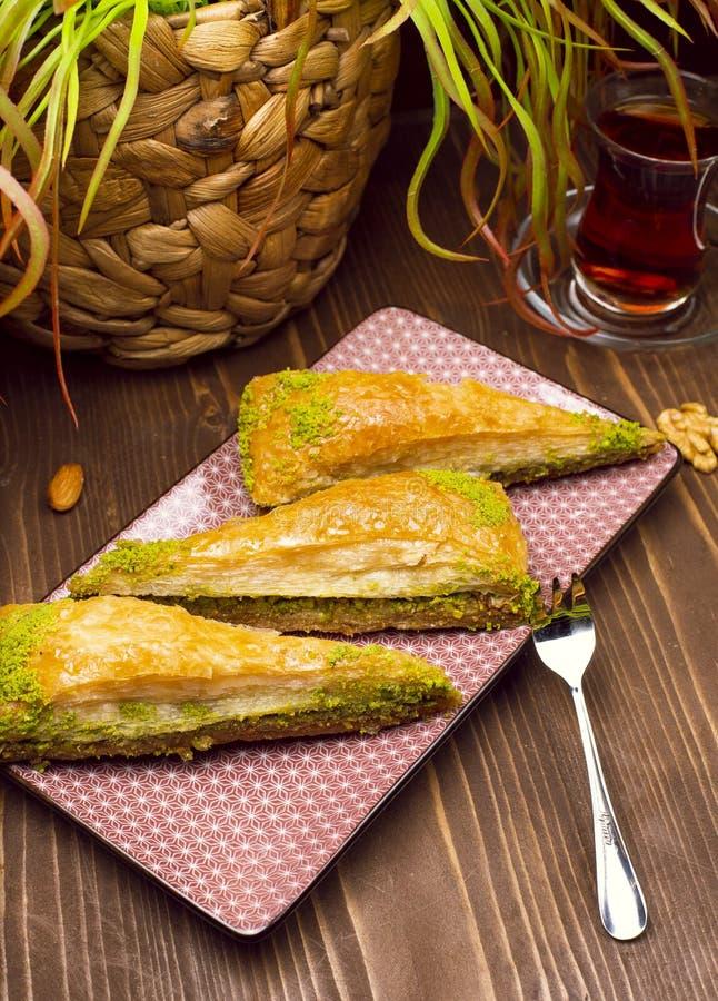Walnut, pistachio turkish style antep baklava. Presentation and service - Image stock images