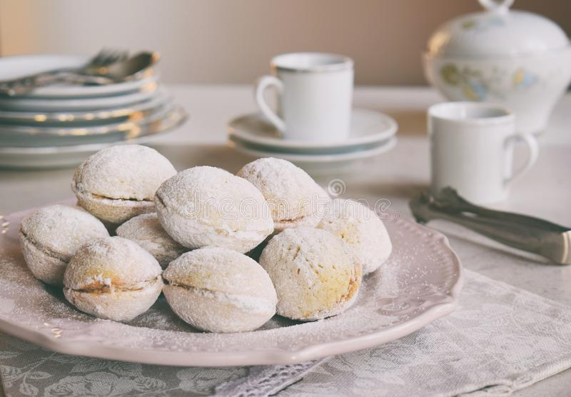 Walnut shaped cookies with cream. Shortbread with caramel and walnuts stuffing. Russian or ukrainian sweets oreshki. Copy Space.  stock image