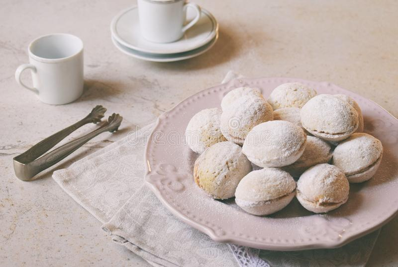 Walnut shaped cookies with cream. Shortbread with caramel and walnuts stuffing. Russian or ukrainian sweets oreshki. Copy Space.  stock photos