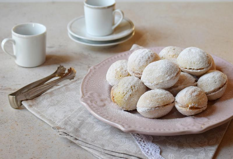 Walnut shaped cookies with cream. Shortbread with caramel and walnuts stuffing. Russian or ukrainian sweets oreshki. Copy Space.  royalty free stock image