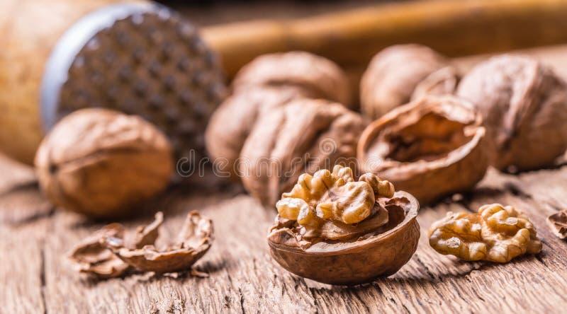 Walnut. Walnut kernels and whole walnuts on rustic old oak table.  stock photo