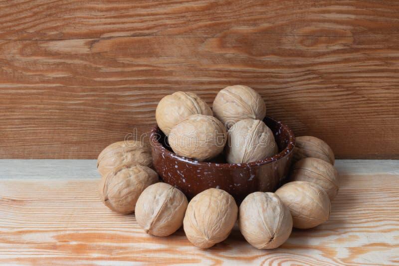 walnut on wooden background stock photo