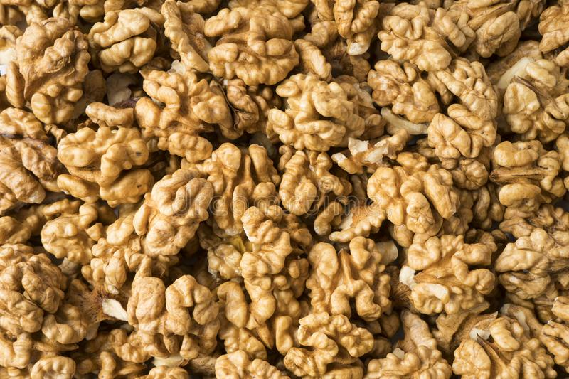 Walnuts background. Kernels walnuts. Top view. Vegetarian or healthy eating. Background of walnuts royalty free stock image