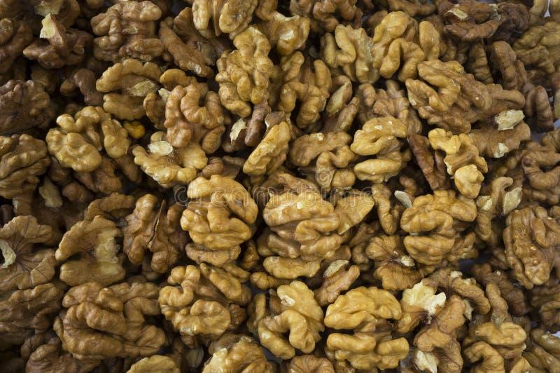 Walnuts background. Kernels walnuts. Vegetarian or healthy eating. Walnuts background. Kernels walnuts. Top view. Vegetarian or healthy eating stock photos