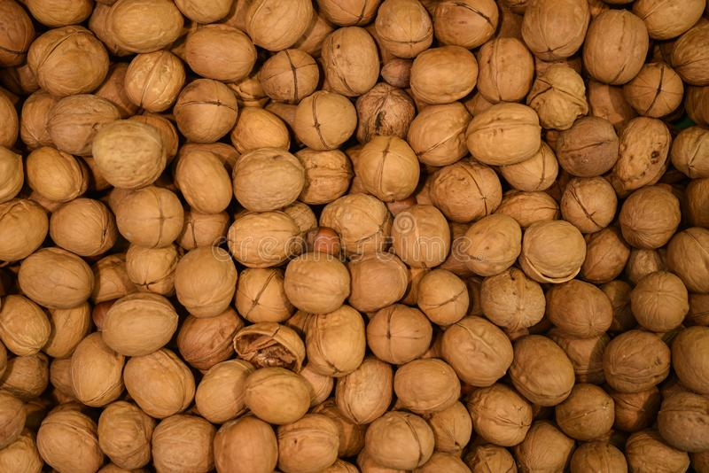Walnuts background. Walnuts pattern for sale in market. Agriculture and nuts product stock image