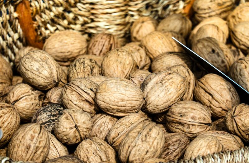 Walnuts in a Basket for Sale, Closeup. Healthy Food for Winter Days.  royalty free stock images