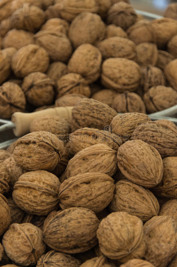 Walnuts in baskets. Walnuts on wooden table in baskets stock photo