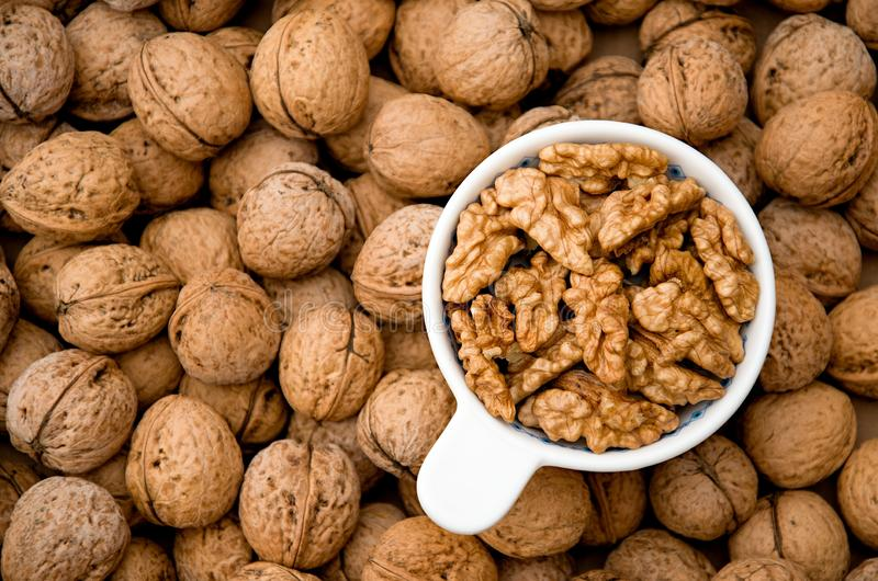 Walnuts on a bowl from above. Healthy food and snack royalty free stock photos
