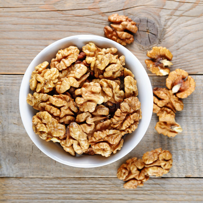 Walnuts in bowl royalty free stock photography
