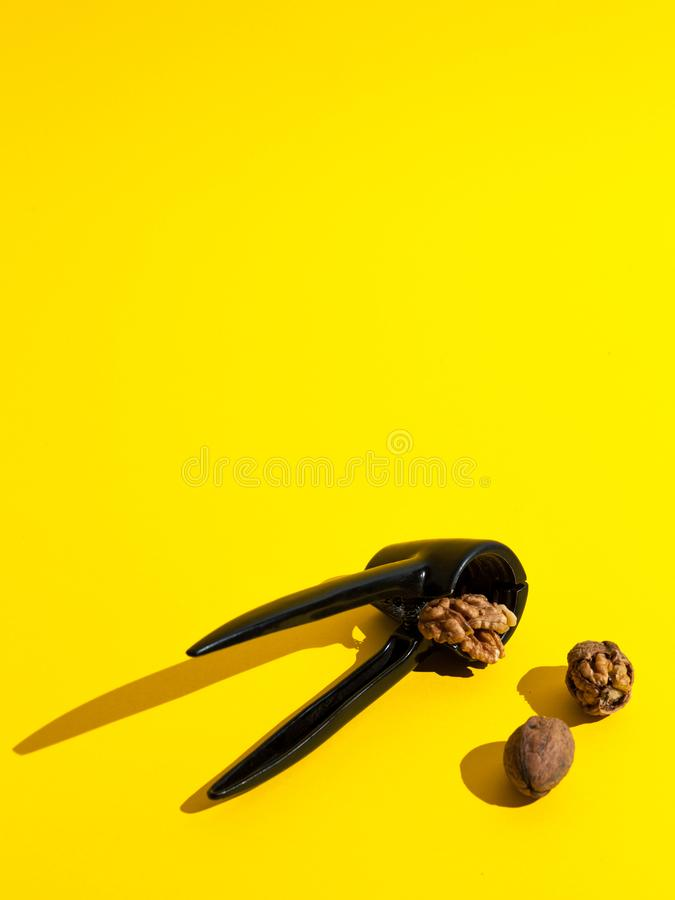 Walnuts crushed on yellow background royalty free stock photo