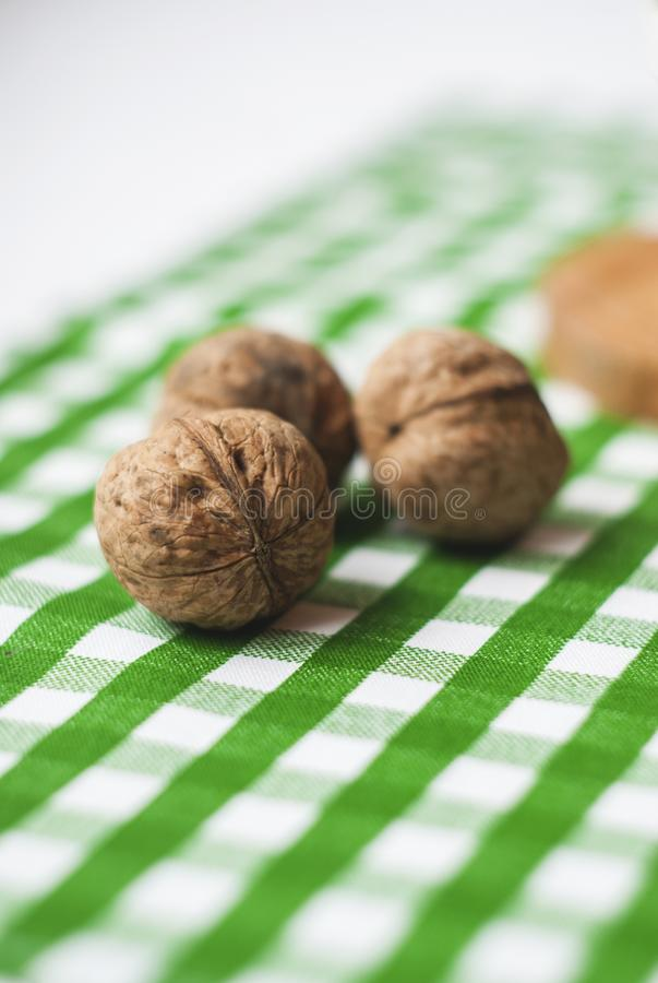 Walnuts on green textile close-up royalty free stock photography