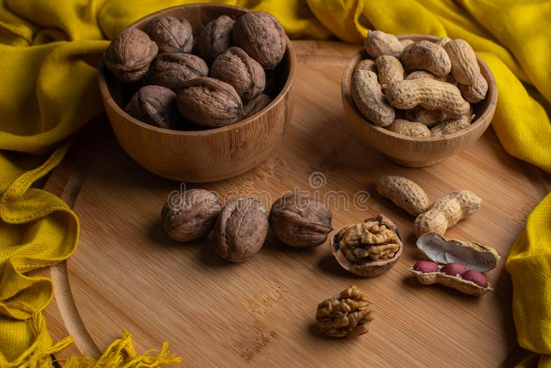 Walnuts kernels on dark desk with color background, Whole walnut in wood vintage bowl, Nuts in bamboo wooden bowl, walnuts in wood royalty free stock images