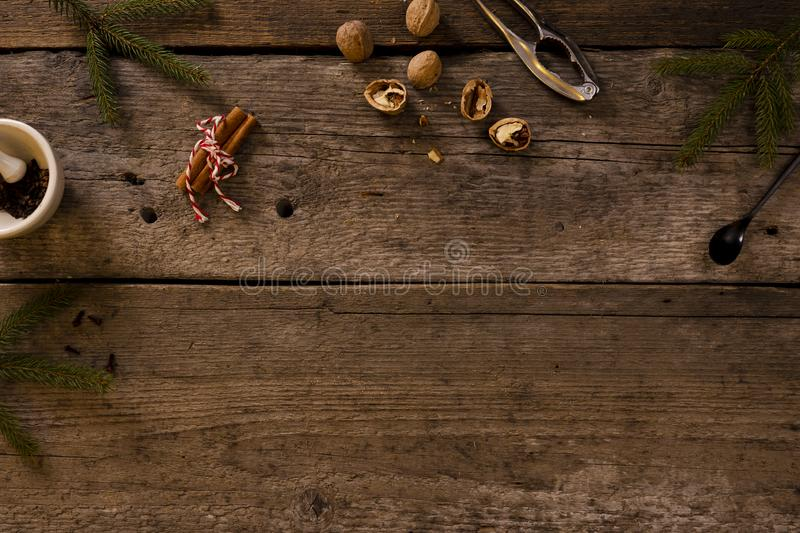 Walnuts and nutcracker on rustic wooden background. copy space for text. Around the branches of spruce. Christmas scenery royalty free stock photography