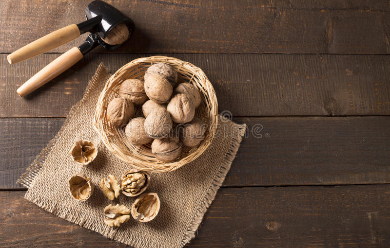 Walnuts with nutcracker royalty free stock photography