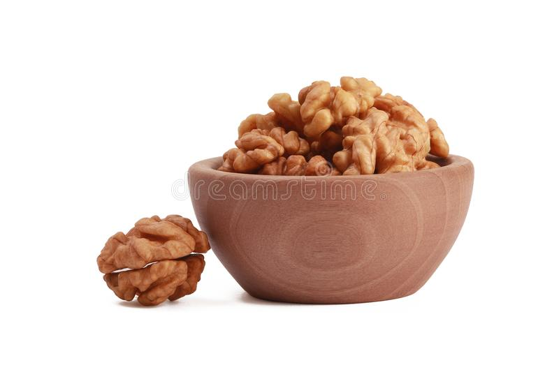 Walnuts shelled in a bowl isolated on white background. Side view. Walnut kernels in a bowl. royalty free stock photo