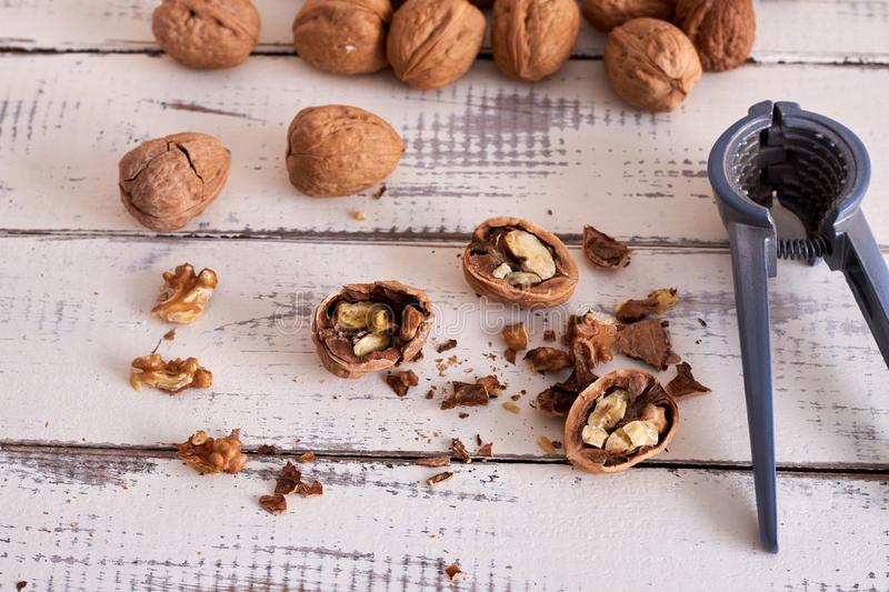 Walnuts on table and open walnuts, some open royalty free stock photography