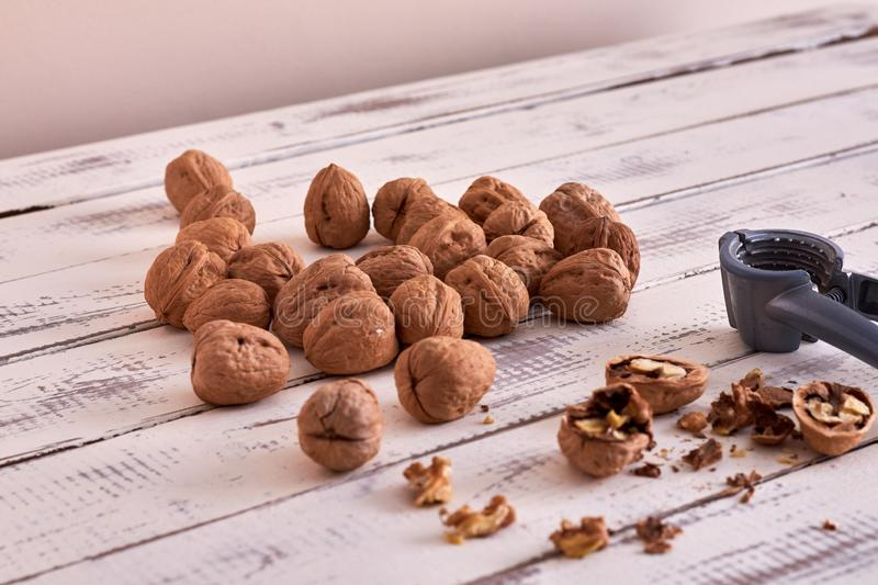 Walnuts on table and open walnuts, some open royalty free stock photos