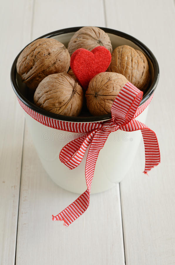 Download Walnuts In White Cup Bounded Up In Red Ribbon Stock Images - Image: 28011364