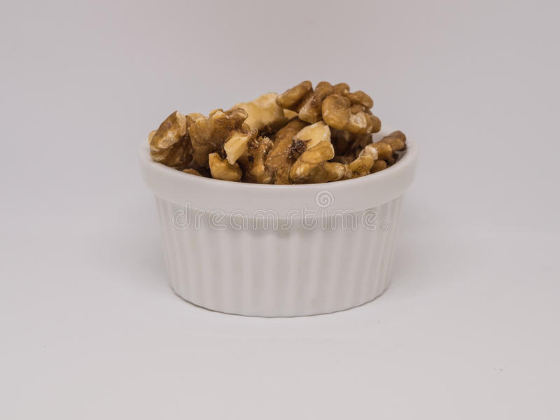 Walnuts in the white cup royalty free stock photos
