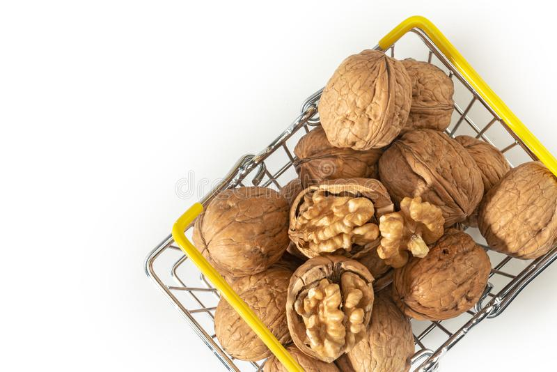 Walnuts on wire basket royalty free stock photography