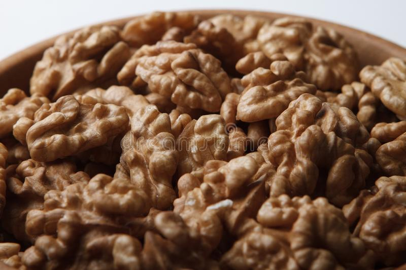 Walnuts in wooden bowl stock photography