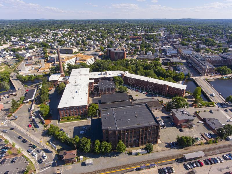 Waltham city center aerial view, Massachusetts, USA. Waltham city center and historic Francis Cabot Lowell Mill next to Charles River aerial view in downtown royalty free stock photos