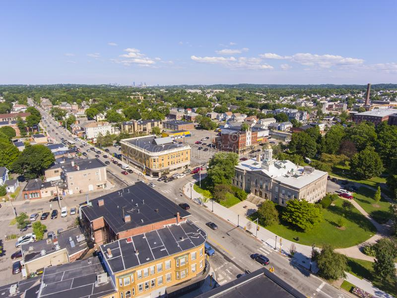 Waltham City Hall aerial view, Massachusetts, USA. Waltham City Hall and downtown with Boston skyline at the background aerial view in downtown Waltham royalty free stock photos